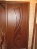 Установленная шпонированная дверь. Установка двери Владимир.