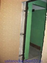 Крепеж нагелем через ушко металлической входной двери.Установка дверей во Владимире.