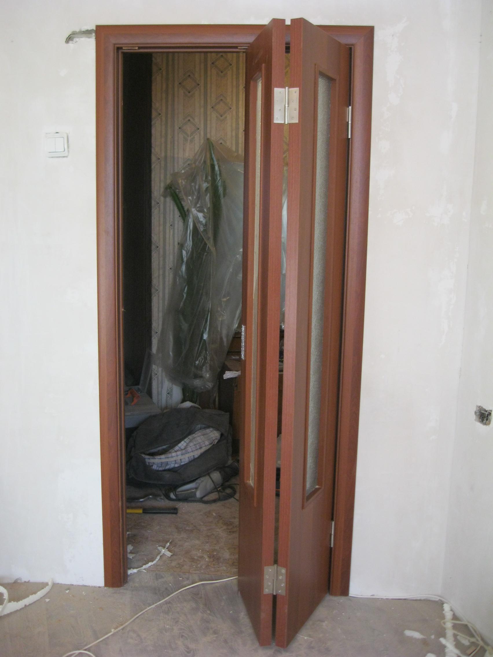 Установка дверей во Владимире. Как установить дверь-книжку.